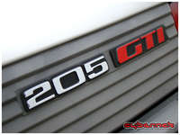 ...slated tailgate panel with 205 and GTI logos...