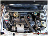 Standard 1.9 engine layout. Even the jack is in its original position! Could do with a clean as well.