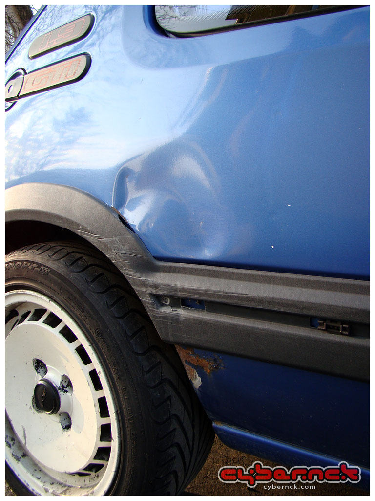 An ugly-looking ripple, caused by a recent bump, starting to rust where the paintwork had peeled off.