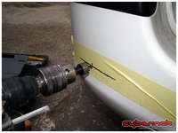 Drilling the bumper with the supplied drill-bit.