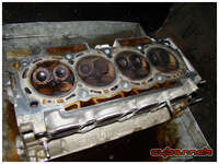 The head showed no signs of damage and the head gasket didn't have any obvious indications of failure either. Still,  the head was sent off for a rebuild and a leak-down test.