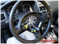Next up, the steering wheel. After disconnecting the battery, airbag is easily removed using two flat-headed screwdrivers inserted in the holes at the back of the steering wheel. A word of warning - do not fully unscrew and remove the main torx bolt until you've managed to release the steering wheel from the steering crown, as you'll probably end up tearing off all the airbag connectors!