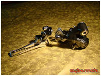 Shimano 105 5502 Black front derailleur and Shimano 105 5600 Black rear derailleur - allows for 10-speed conversion later on and/or easily replaced by a better rear der, if needs be.