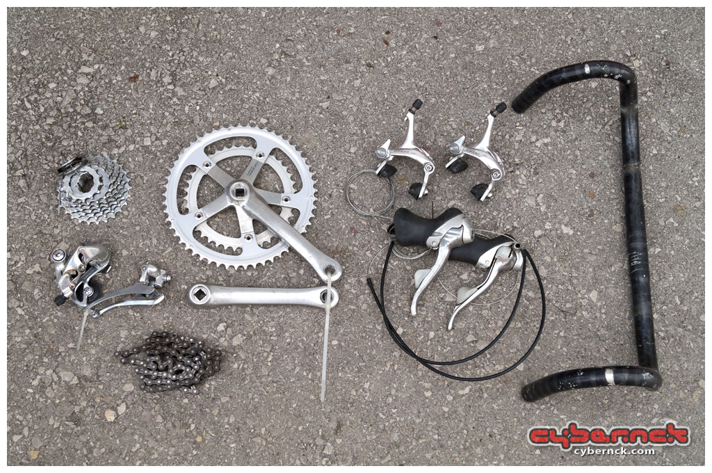 """Having custom-built all my racing bicycles, I thought """"why not, I can do it for someone else as well."""" We had then figured out his desired specs and I picked up a full Shimano RX100 groupset, modern ergo handlebars and Campagnolo Omega rims with Shimano 600 Tricolore hubs."""